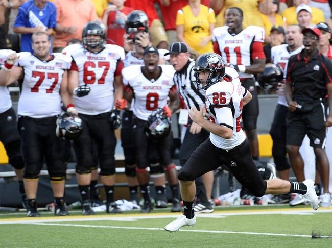 Aug 31, 2013; Iowa City, IA, USA; Northern Illinois Huskies punter Tyler Wedel (26) rushes for a first down on a fake punt against the Iowa Hawkeyes during the fourth quarter at Kinnick Stadium. Northern Illinois defeats Iowa 30-27. Mandatory Credit: Mike DiNovo-USA TODAY Sports