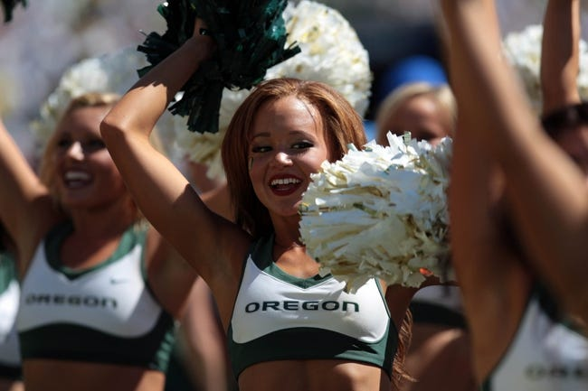Aug 31, 2013; Eugene, OR, USA; Oregon Ducks cheerleaders perform during the game against the Nicholls State Colonels at Autzen Stadium. Mandatory Credit: Scott Olmos-USA TODAY Sports