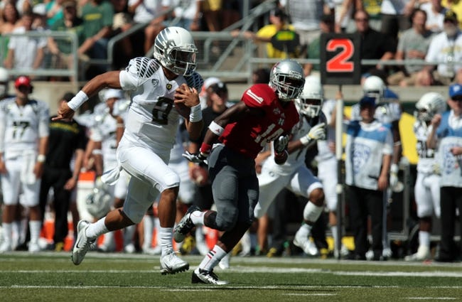 Aug 31, 2013; Eugene, OR, USA; Oregon Ducks quarterback Marcus Mariota (8) runs the ball for a touchdown against the Nicholls State Colonels at Autzen Stadium. Mandatory Credit: Scott Olmos-USA TODAY Sports