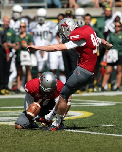 Aug 31, 2013; Eugene, OR, USA; Nicholls State Colonels kicker Andrew Dolan (98) kicks a field goal against the Oregon Ducks at Autzen Stadium. Mandatory Credit: Scott Olmos-USA TODAY Sports