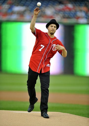 Aug 31, 2013; Washington, DC, USA; Recording artist Gavin DeGraw throws out the first pitch before a game between the New York Mets and the Washington Nationals at Nationals Park. Mandatory Credit: Joy R. Absalon-USA TODAY Sports