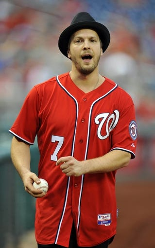 Aug 31, 2013; Washington, DC, USA; Recording artitst Gavin DeGraw gets ready to throw out the first pitch before a game between the New York Mets and the Washington Nationals at Nationals Park. Mandatory Credit: Joy R. Absalon-USA TODAY Sports