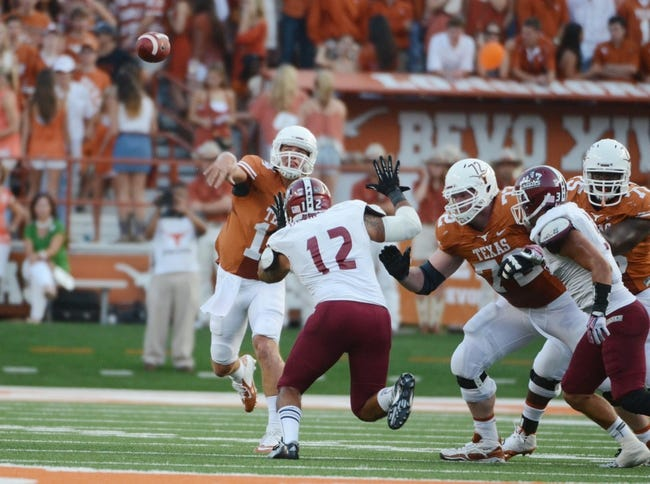 Aug 31, 2013; Austin, TX, USA; Texas Longhorns quarterback David Ash (14) passes the ball against the New Mexico State Aggies during the first half at Darrell K Royal-Texas Memorial Stadium. Mandatory Credit: Brendan Maloney-USA TODAY Sports