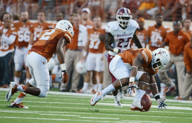 Aug 31, 2013; Austin, TX, USA; Texas Longhorns cornerback Quandre Diggs (6) recovers a fumble against the New Mexico State Aggies during the first half at Darrell K Royal-Texas Memorial Stadium. Mandatory Credit: Brendan Maloney-USA TODAY Sports