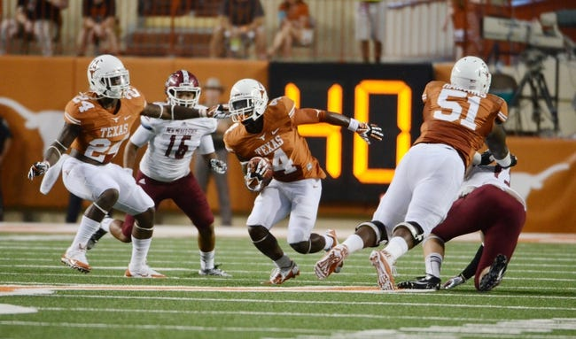 Aug 31, 2013; Austin, TX, USA; Texas Longhorns wide receiver Daje Johnson (4) carries the ball against the New Mexico State Aggies during the first half at Darrell K Royal-Texas Memorial Stadium. Mandatory Credit: Brendan Maloney-USA TODAY Sports