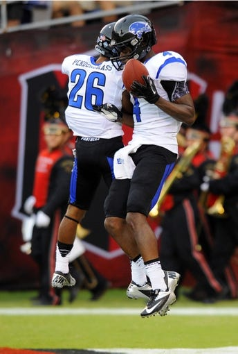 Aug 31, 2013; San Diego, CA, USA; Eastern Illinois Panthers reeiver Keiondre Gober (4) celebrates with receiver Trey Pendergrass (26) after a touchdown during the first half against the San Diego State Aztecs at Qualcomm Stadium. Mandatory Credit: Christopher Hanewinckel-USA TODAY Sports