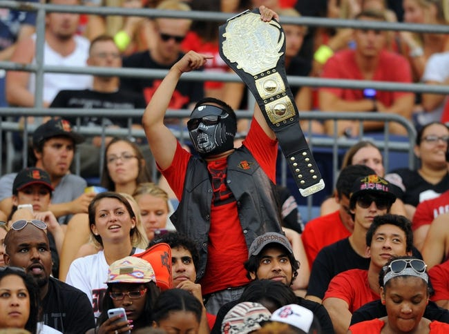 Aug 31, 2013; San Diego, CA, USA; A fan in the San Diego State Aztecs student section holds a championship belt during the first half against the Eastern Illinois Panthers at Qualcomm Stadium. Mandatory Credit: Christopher Hanewinckel-USA TODAY Sports