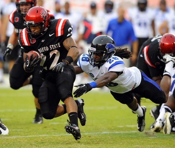 Aug 31, 2013; San Diego, CA, USA; San Diego State Aztecs running back Chase Price (22) gets away from a tackle attempt by Eastern Illinois Panthers defensive back Nick Beard (28) during the first half at Qualcomm Stadium. Mandatory Credit: Christopher Hanewinckel-USA TODAY Sports