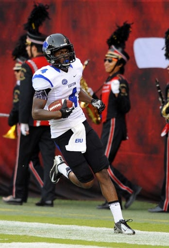 Aug 31, 2013; San Diego, CA, USA; Eastern Illinois Panthers reeiver Keiondre Gober (4) celebrates after a touchdown during the first half against the San Diego State Aztecs at Qualcomm Stadium. Mandatory Credit: Christopher Hanewinckel-USA TODAY Sports