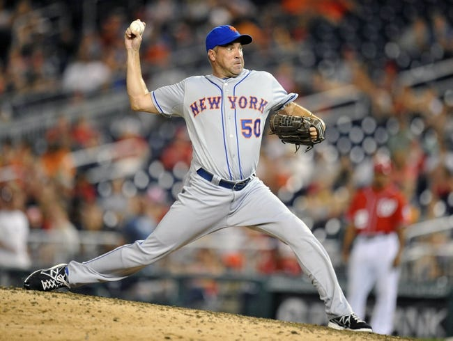 Aug 31, 2013; Washington, DC, USA; New York Mets pitcher Scott Atchison (50) throws in the ninth inning against the Washington Nationals at Nationals Park. The Mets defeated the Nationals 11-3. Mandatory Credit: Joy R. Absalon-USA TODAY Sports