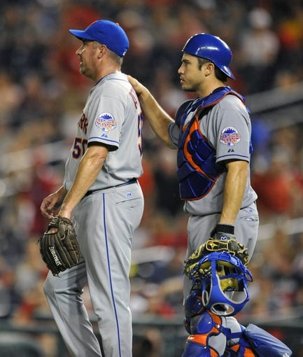 Aug 31, 2013; Washington, DC, USA; New York Mets pitcher Scott Atchison (50) is congratulated by catcher Travis d'Arnaud (15) after a game against the Washington Nationals at Nationals Park. The Mets defeated the Nationals 11-3. Mandatory Credit: Joy R. Absalon-USA TODAY Sports