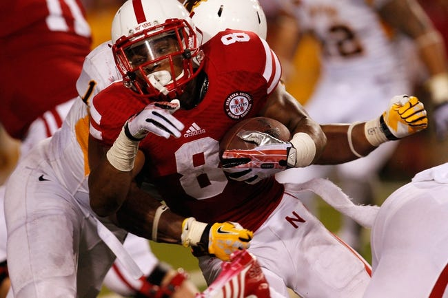 Aug 31, 2013; Lincoln, NE, USA; Nebraska Cornhuskers running back Ameer Abdullah (8) rushes against the Wyoming Cowboys in the second half at Memorial Stadium. Mandatory Credit: Bruce Thorson-USA TODAY Sports