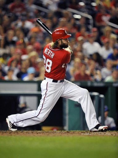 Aug 31, 2013; Washington, DC, USA; Washington Nationals right fielder Jayson Werth (28) hits a one-run rbi sacrifice fly in the sixth inning against the New York Mets at Nationals Park. The Mets defeated the Nationals 11-3. Mandatory Credit: Joy R. Absalon-USA TODAY Sports