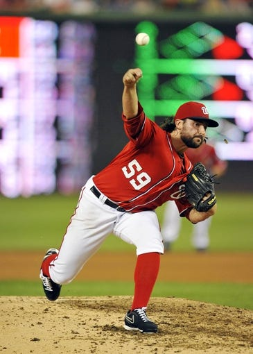 Aug 31, 2013; Washington, DC, USA; Washington Nationals pitcher Tanner Roark (59) throws in the sixth inning against the New York Mets at Nationals Park. The Mets defeated the Nationals 11-3. Mandatory Credit: Joy R. Absalon-USA TODAY Sports