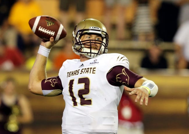 Aug 31, 2013; Hattiesburg, MS, USA; Texas State Bobcats quarterback Tyler Arndt (12) throws a pass in the fourth quarter against the Southern Miss Golden Eagles at M.M. Roberts Stadium.Texas State won, 22-15. Mandatory Credit: Chuck Cook-USA TODAY Sports