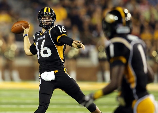Aug 31, 2013; Hattiesburg, MS, USA; Southern Miss Golden Eagles quarterback Allan Bridgford (16) makes a throw against the Texas State Bobcats at M.M. Roberts Stadium. Texas State won, 22-15. Mandatory Credit: Chuck Cook-USA TODAY Sports