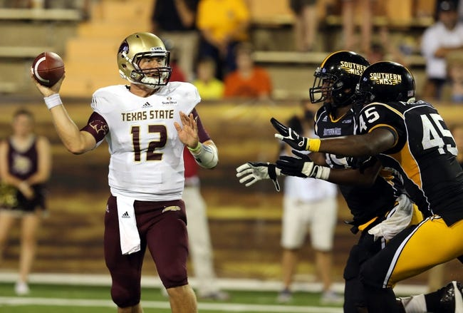 Aug 31, 2013; Hattiesburg, MS, USA; Texas State Bobcats quarterback Tyler Arndt (12) throws a pass under pressure from Southern Miss Golden Eagles defensive linemen Octavius Thomas (99) and Dasman McCullum (45) in the fourth quarter at M.M. Roberts Stadium.Texas State won, 22-15. Mandatory Credit: Chuck Cook-USA TODAY Sports