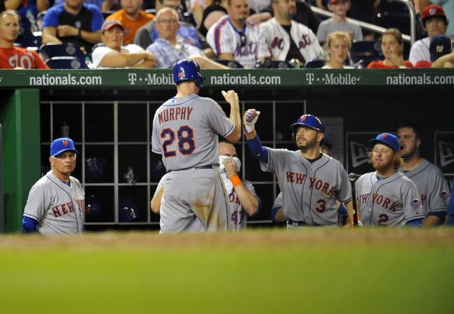 Aug 31, 2013; Washington, DC, USA; New York Mets second baseman Daniel Murphy (28) is congratulated by teammates after scoring in the eighth inning against the Washington Nationals at Nationals Park. The Mets defeated the Nationals 11-3. Mandatory Credit: Joy R. Absalon-USA TODAY Sports