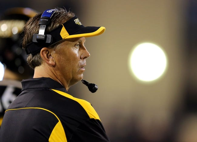 Aug 31, 2013; Hattiesburg, MS, USA; Southern Miss Golden Eagles head coach Todd Monken watches his team play against the Texas State Bobcats in the fourth quarter at M.M. Roberts Stadium.Texas State won, 22-15. Mandatory Credit: Chuck Cook-USA TODAY Sports