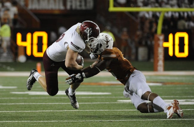 Aug 31, 2013; Austin, TX, USA; Texas Longhorns corner back Quandre Diggs (6) tackles New Mexico State Aggies tight end Andrew Dean (89) during the second half at Darrell K Royal-Texas Memorial Stadium. Texas beat New Mexico State 56-7. Mandatory Credit: Brendan Maloney-USA TODAY Sports