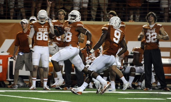 Aug 31, 2013; Austin, TX, USA; Texas Longhorns tailback Malcolm Brown (28) carries the ball for a touchdown against the New Mexico State Aggies during the second half at Darrell K Royal-Texas Memorial Stadium. Texas beat New Mexico State 56-7. Mandatory Credit: Brendan Maloney-USA TODAY Sports