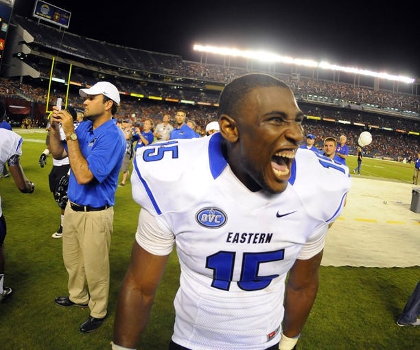 Aug 31, 2013; San Diego, CA, USA; Eastern Illinois Panthers linebacker Antonio Taylor (15) celebrates following a 40-18 win against the San Diego State Aztecs at Qualcomm Stadium. Mandatory Credit: Christopher Hanewinckel-USA TODAY Sports