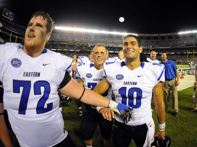 Aug 31, 2013; San Diego, CA, USA; Eastern Illinois Panthers quarterback Jimmy Garoppolo (10) and Alex Pierce (72) celebrate following a 40-18 win against the San Diego State Aztecs at Qualcomm Stadium. Mandatory Credit: Christopher Hanewinckel-USA TODAY Sports