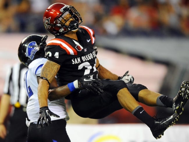 Aug 31, 2013; San Diego, CA, USA; San Diego State Aztecs wide receiver Colin Lockett (24) is upended after missing a pass during the second half against the Eastern Illinois Panthers at Qualcomm Stadium. Mandatory Credit: Christopher Hanewinckel-USA TODAY Sports