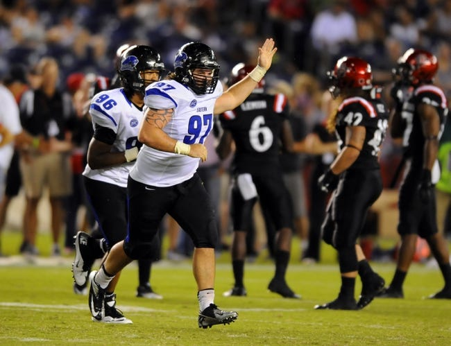 Aug 31, 2013; San Diego, CA, USA; Eastern Illinois Panthers defensive tackle Dino Fanti (97) celebrates after recovering a fumble during the second half against the San Diego State Aztecs at Qualcomm Stadium. Mandatory Credit: Christopher Hanewinckel-USA TODAY Sports