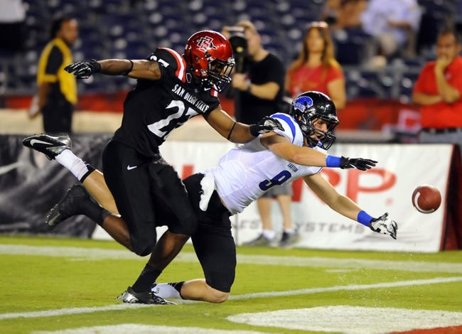 Aug 31, 2013; San Diego, CA, USA; Eastern Illinois Panthers receiver Jeff LePak (9) is unable to make a diving catch while defended by San Diego State Aztecs defensive back Eric Pinkins (27) during the second half at Qualcomm Stadium. Mandatory Credit: Christopher Hanewinckel-USA TODAY Sports