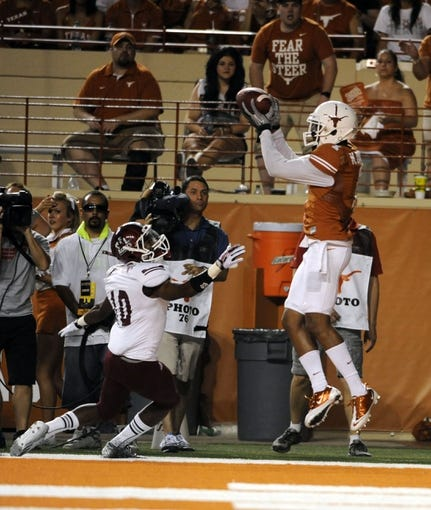 Aug 31, 2013; Austin, TX, USA; Texas Longhorns wide receiver Mike Davis (1) cathces a pass for a touchdown against the New Mexico State Aggies during the second half at Darrell K Royal-Texas Memorial Stadium. Texas beat New Mexico State 56-7. Mandatory Credit: Brendan Maloney-USA TODAY Sports