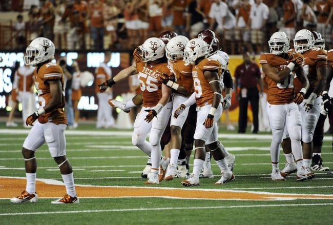 Aug 31, 2013; Austin, TX, USA; Texas Longhorns linebackers Dalton Santos (55) and Kendall Thompson (35) and Peter Jinkens (19) react against the New Mexico State Aggies during the second half at Darrell K Royal-Texas Memorial Stadium. Texas beat New Mexico State 56-7. Mandatory Credit: Brendan Maloney-USA TODAY Sports