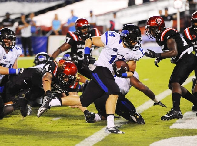 Aug 31, 2013; San Diego, CA, USA; Eastern Illinois Panthers running back Taylor Duncan (14) runs for a touchdown  during the second half against the San Diego State Aztecs at Qualcomm Stadium. Mandatory Credit: Christopher Hanewinckel-USA TODAY Sports