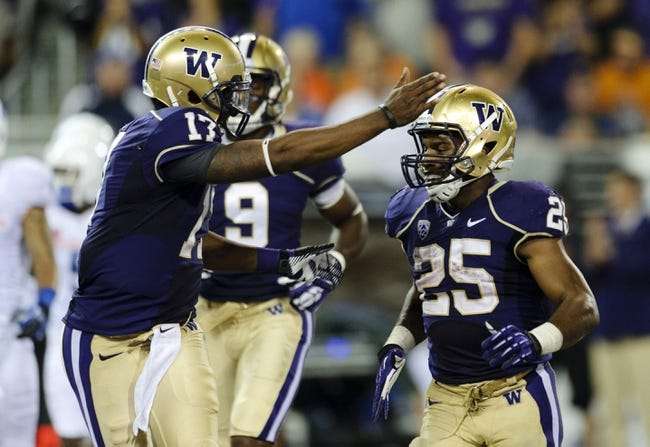 Aug 31, 2013; Seattle, WA, USA; Washington Huskies quarterback Keith Price (17) celebrates with Washington Huskies running back Bishop Sankey (25) after Sankey ran the ball in for a touchdown against the Boise State Broncos during the 2nd half at Husky Stadium. Washington defeated Boise State 38-6. Mandatory Credit: Steven Bisig-USA TODAY Sports