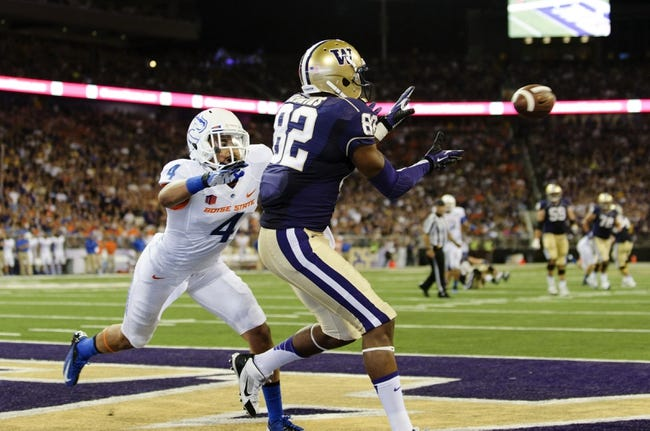 Aug 31, 2013; Seattle, WA, USA; Washington Huskies tight end Joshua Perkins (82) catches a pass for a touchdown while being covered by Boise State Broncos safety Darian Thompson (4) during the 2nd half at Husky Stadium. Washington defeated Boise State 38-6. Mandatory Credit: Steven Bisig-USA TODAY Sports