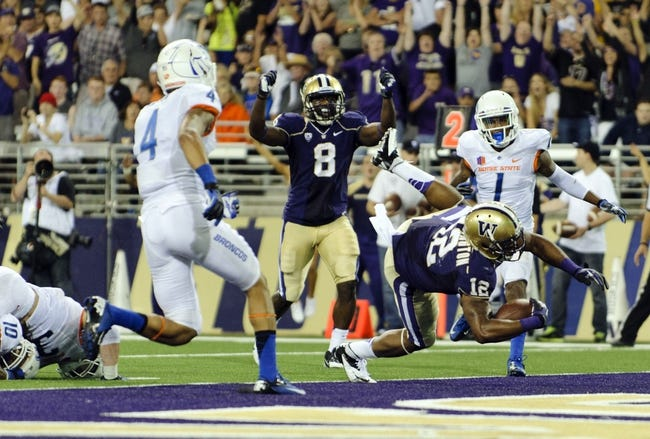 Aug 31, 2013; Seattle, WA, USA; Washington Huskies running back Dwayne Washington (12) dives in for a touchdown against the Boise State Broncos during the 2nd half at Husky Stadium. Washington defeated Boise State 38-6. Mandatory Credit: Steven Bisig-USA TODAY Sports