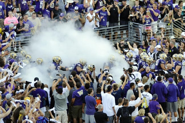 Aug 31, 2013; Seattle, WA, USA; The Washington Huskies enter the field during the opening ceremonies of the game between the Washington Huskies and the Boise State Broncos at Husky Stadium. Washington defeated Boise State 38-6. Mandatory Credit: Steven Bisig-USA TODAY Sports