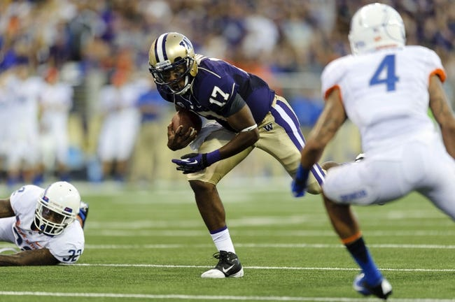 Aug 31, 2013; Seattle, WA, USA; Washington Huskies quarterback Keith Price (17) carries the ball during the game against the Boise State Broncos at Husky Stadium. Washington defeated Boise State 38-6. Mandatory Credit: Steven Bisig-USA TODAY Sports