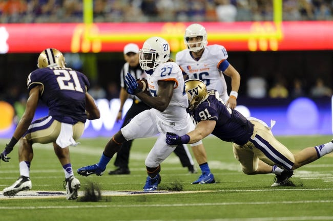Aug 31, 2013; Seattle, WA, USA; Boise State Broncos running back Jay Ajayi (27) carries the ball with Washington Huskies defensive end Connor Cree (91) attempting the tackle during the game at Husky Stadium. Washington defeated Boise State 38-6. Mandatory Credit: Steven Bisig-USA TODAY Sports