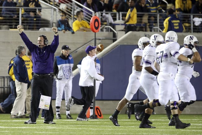 Aug 31, 2013; Berkeley, CA, USA; Northwestern Wildcats head coach Pat Fitzgerald celebrates after an interception return for a touchdown against the California Golden Bears during the third quarter at Memorial Stadium. Northwestern won 44-30. Mandatory Credit: Kelley L Cox-USA TODAY Sports