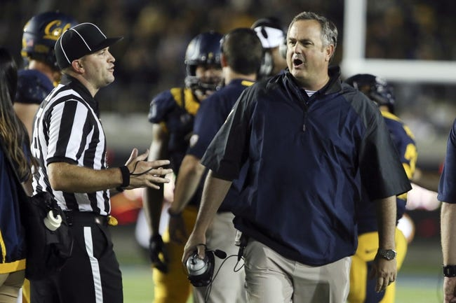 Aug 31, 2013; Berkeley, CA, USA; California Golden Bears head coach Sonny Dykes reacts after an injury by the Northwestern Wildcats during the third quarter at Memorial Stadium. Northwestern won 44-30. Mandatory Credit: Kelley L Cox-USA TODAY Sports