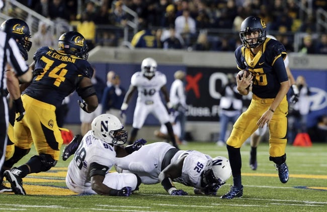 Aug 31, 2013; Berkeley, CA, USA; California Golden Bears quarterback Jared Goff (16) runs with the ball against the Northwestern Wildcats during the fourth quarter at Memorial Stadium. Northwestern won 44-30. Mandatory Credit: Kelley L Cox-USA TODAY Sports