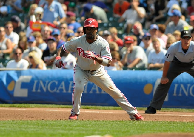Sep 1, 2013; Chicago, IL, USA; Philadelphia Phillies shortstop Jimmy Rollins (11) leads off first base during the first inning against the Chicago Cubs at Wrigley Field. Mandatory Credit: Reid Compton-USA TODAY Sports