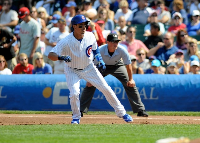 Sep 1, 2013; Chicago, IL, USA; Chicago Cubs second baseman Darwin Barney (15) leads off first base during the first inning against the Philadelphia Phillies at Wrigley Field. Mandatory Credit: Reid Compton-USA TODAY Sports