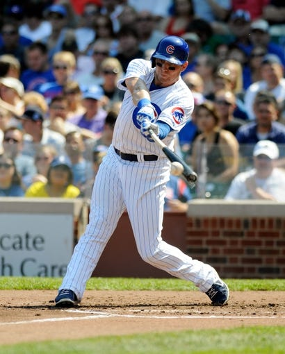 Sep 1, 2013; Chicago, IL, USA; Chicago Cubs center fielder Ryan Sweeney (6) hits an RBI single during the first inning against the Philadelphia Phillies at Wrigley Field. Mandatory Credit: Reid Compton-USA TODAY Sports