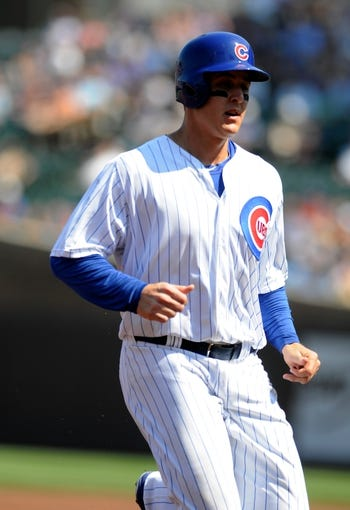 Sep 1, 2013; Chicago, IL, USA; Chicago Cubs first baseman Anthony Rizzo (44) reaches third base on an RBI single by center fielder Ryan Sweeney (not pictured) during the first inning against the Philadelphia Phillies at Wrigley Field. Mandatory Credit: Reid Compton-USA TODAY Sports