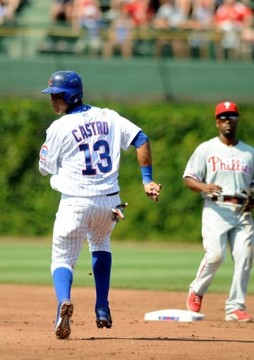 Sep 1, 2013; Chicago, IL, USA; Chicago Cubs shortstop Starlin Castro (13) looks back as he runs to second base during the third inning against the Philadelphia Phillies at Wrigley Field. Mandatory Credit: Reid Compton-USA TODAY Sports