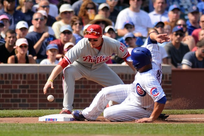 Sep 1, 2013; Chicago, IL, USA; Chicago Cubs catcher Welington Castillo (53) is safe at third base as Philadelphia Phillies third baseman Cody Asche (25) reaches for the ball during the fourth inning at Wrigley Field. Mandatory Credit: Reid Compton-USA TODAY Sports