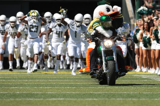 Aug 31, 2013; Eugene, OR, USA; Oregon ducks mascot rides on the back of a motorcycle before the game against the Nicholls State Colonels at Autzen Stadium. Mandatory Credit: Scott Olmos-USA TODAY Sports
