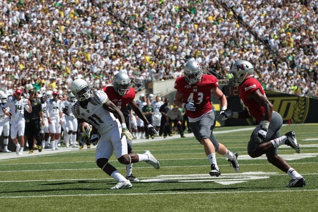 Aug 31, 2013; Eugene, OR, USA; Oregon Ducks wide receiver Bralon Addison (11) runs the ball past Nicholls State Colonels linebacker Ryan Bruno (43) for a touchdown at Autzen Stadium. Mandatory Credit: Scott Olmos-USA TODAY Sports